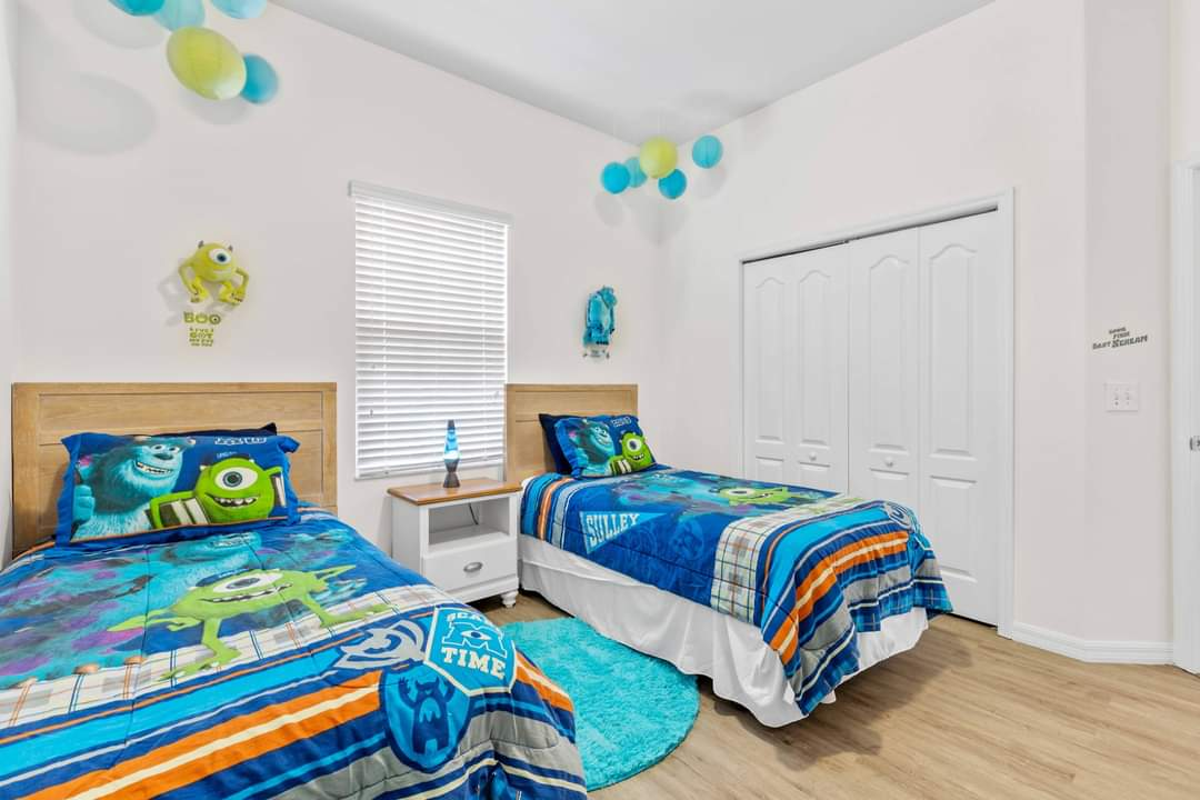 Monsters Inc themed twin bedroom with shared bathroom