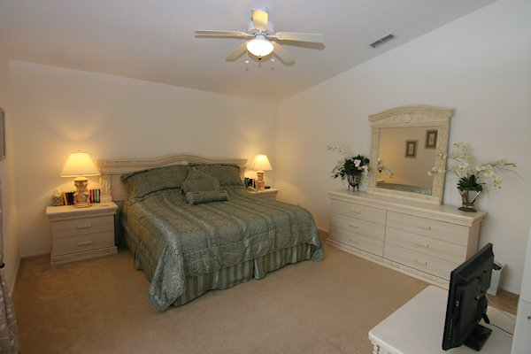 King size master bedroom with ensuite, over looks pool area