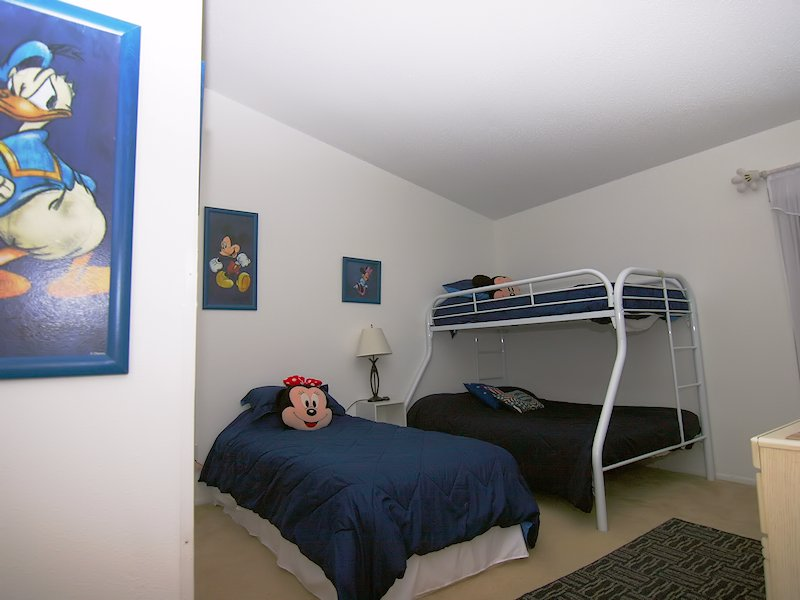 Disney themed room with single and full with single over