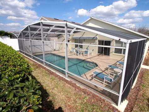Screened pool area with privacy hedging and fencing