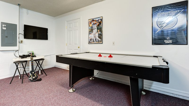 Games room with TV and gaming area