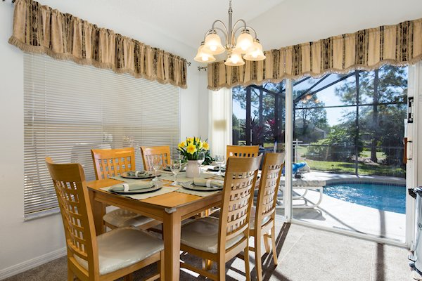 Dining room with view to pool & patio area