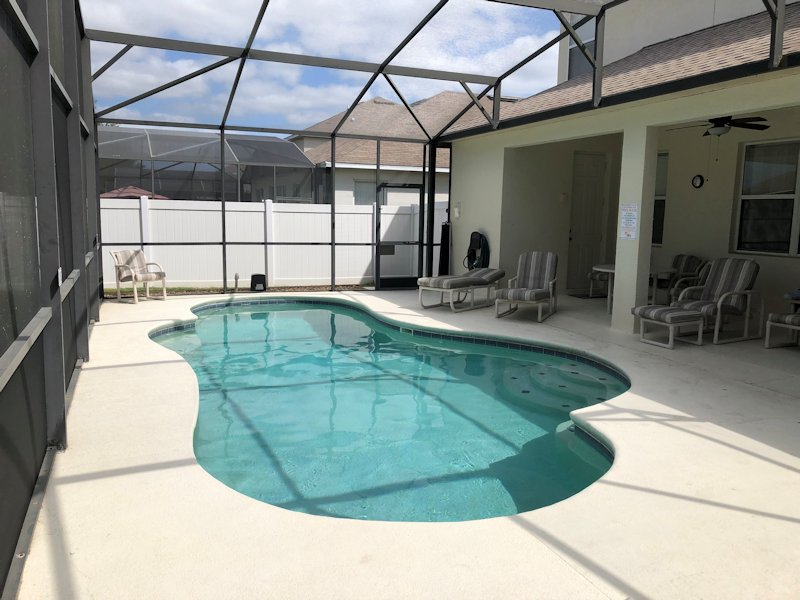 Private pool, patio and shaded seating area.