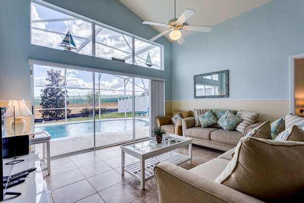LIVING ROOM OVER LOOKING POOL